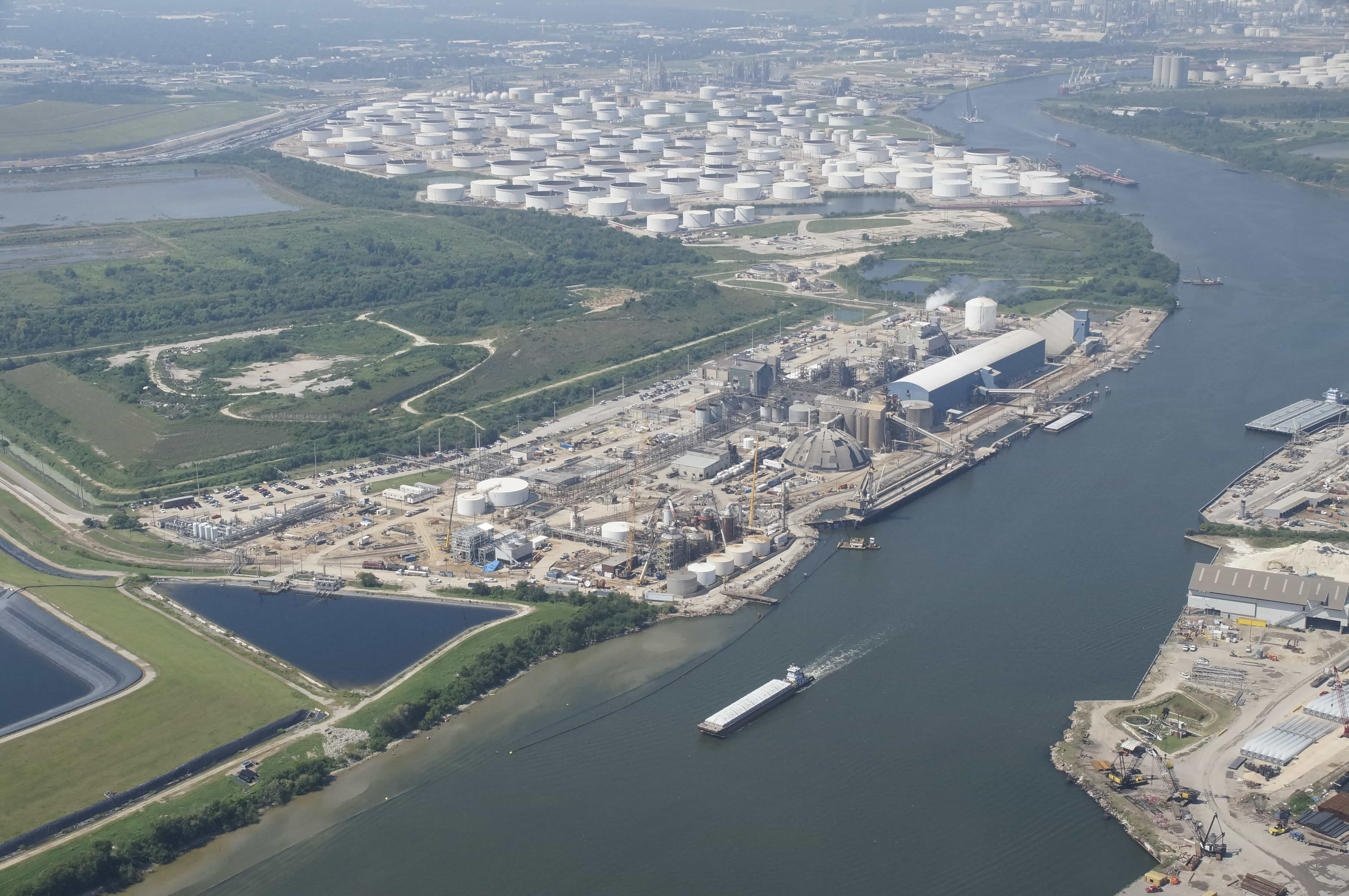 Aerial view of the PCI Nitrogen plant as a barge passes on the Houston Ship Channel.